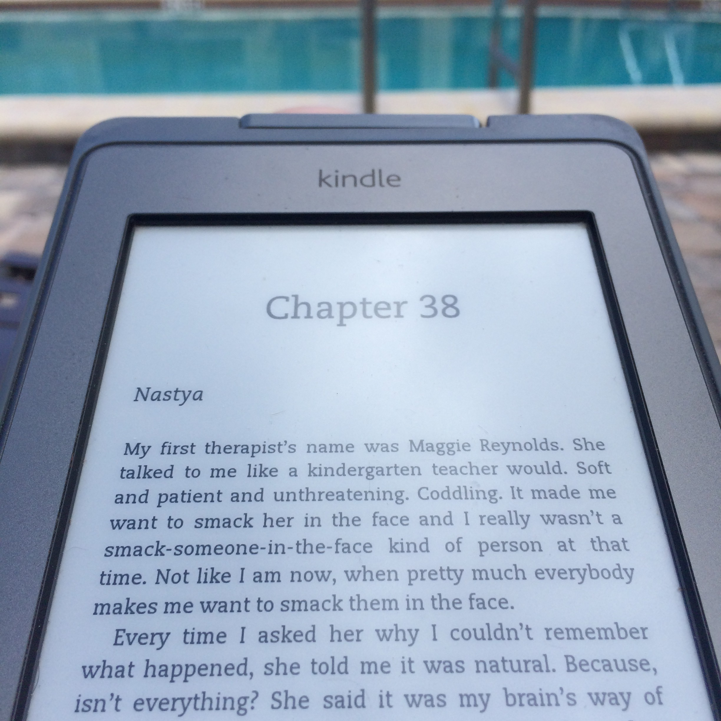 kindle reading by pool